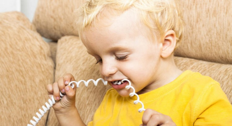 Child biting phone wire